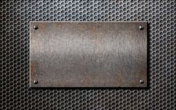 Old metal rusty or rustic plate over grid Stock Photo