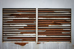 Rusty ventilation windows on wall Stock Photography