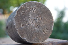 Old metal sample with marking Royalty Free Stock Image
