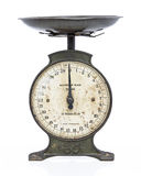 Old metal scales. On white studio backdrop royalty free stock photo