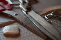 Old metal scissors, chalk, safety pins and tailor measure tape o royalty free stock photography