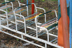 Old metal seat in kid playground. In the park Royalty Free Stock Images