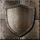 Old metal shield over armor background Royalty Free Stock Photography