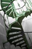 Old metal spiral stair in a factory Stock Photo