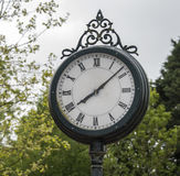 Old metal station clock Royalty Free Stock Photos