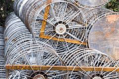 Old metal take up reel for film projector with arrange overlappi. Ng a lot of Stock Photo
