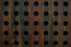 Old metal texture with round holes Stock Photography