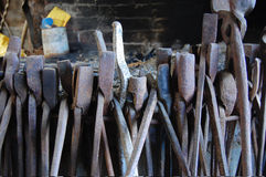 Old metal tools at forge Stock Photos