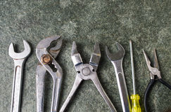 Old metal tools on a stone table Royalty Free Stock Photo