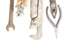 Old metal tools on top. On white background royalty free stock image