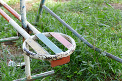 Old metal toy in kid playground. In the park Stock Photography