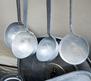 Old metal utensils for cooking on a local market.  Stock Image