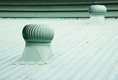 Old metal ventilator on the roof of factory. Royalty Free Stock Photos