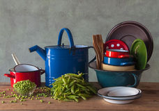 Old metal vessels and fresh peas Stock Images