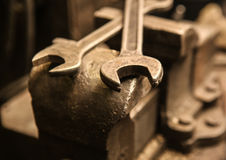 Old metal vice and wrenches Royalty Free Stock Images