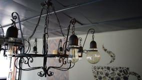 Old metal vintage chandelier. On ceiling stock footage