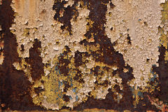 Old metal wall colored in brown. Background. Stock Photos