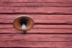 Old metal wall light on barn Stock Images