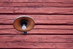 Old metal wall light on barn stock images