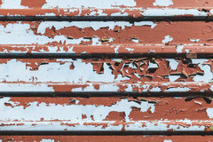 Old metal wall with peeling paint layers Royalty Free Stock Images