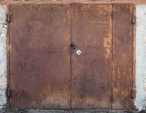 Old metal warehouse door. Hangar stock photo
