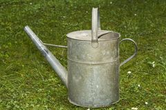 Old metal water can. For gardening royalty free illustration