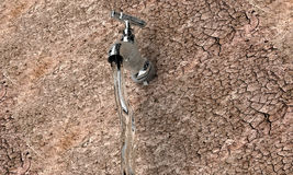 Old metal water tap in dry surrounding Royalty Free Stock Image