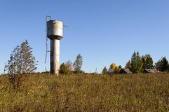 Old metal water tower in the village Stock Photos
