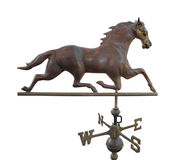 Old metal weather vane with a horse isolated. Old vintage metal weather vane with a running horse.  Isolated on white Stock Images