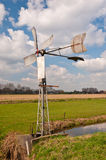 Old metal windmill and a colorful Dutch landscape Stock Photo