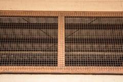 Old metal wire with dust. Old metal net window indoor Stock Photo