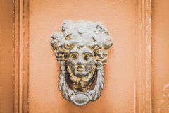 Old Metal Woman Head Knocker on Wooden door in Mdina, Malta Royalty Free Stock Images