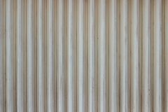 Old metalic rolling door pattern background. Striped vertical line pattern, dirty surface make it has vintage look stock image