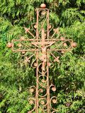 Metallic cross in cemetery. Old metallic cross in Sveksna town cementary , Lithuania Royalty Free Stock Images