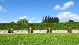 Metallic crosses fence  in cemetery Royalty Free Stock Photo