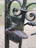 Old metallic gate handle Stock Images