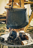 Old metallic kettle on the fire, cooking food Royalty Free Stock Photos