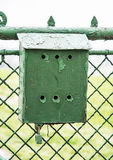Old metallic mailbox on the fence Royalty Free Stock Images