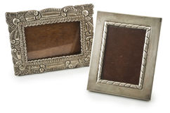 Old metallic photo frame. Two old metallic silver photo frames isolated on white Royalty Free Stock Images