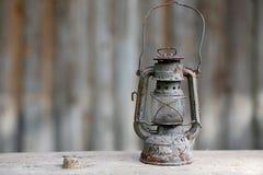 Old metallic rusty kerosene lamp Stock Image