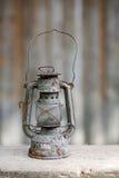 Old metallic rusty kerosene lamp Stock Images