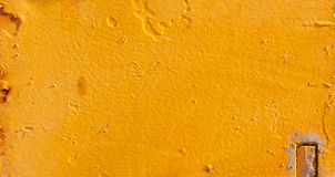 Old metallic surface painted yellow Royalty Free Stock Photos