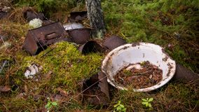 Old metallic waste dumped in the forest. royalty free stock photo