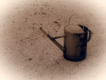 Old metallic watering can. Monochromatic vintage picture style Royalty Free Stock Photos