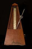 Old metronome with black background Royalty Free Stock Image