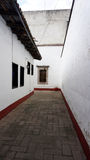 Old mexican alley. An old alley in a construction in mexico, inner construction in a old house looking as a ally with a classic style of begining of the twenty Royalty Free Stock Photography