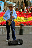 Old Mexican Musician Playing Saxophone. Old mexican street musician playing saxophone. Oaxaca, Mexico Stock Photos