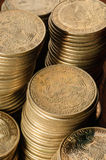 Old Mexican peso coins. Stack Royalty Free Stock Images