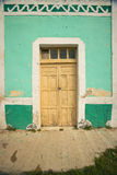 Old Mexican village of Celestun on Gulf of Mexico with old green building storefront Royalty Free Stock Photography