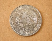 Old Mexico Coin. Isolated on light brown background Stock Photography